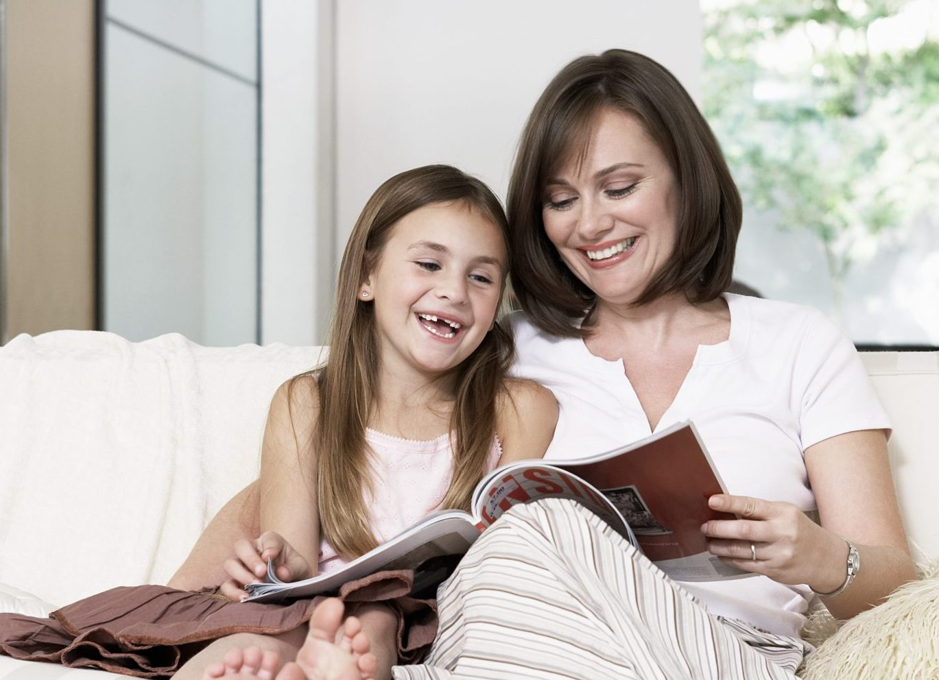 Mother and Daughter Reading Together about Early Childhood Developmental Milestones
